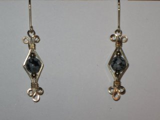 E-10 14 carat golled filled wire with snowflake obsidian and 14 carat gold beads $25.jpg