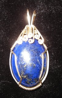 P-30 Lapiz cabochon wrapped in 14 carat gold-filled wire $35.jpg