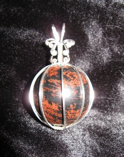 P-38 Mahogany obsidian sphere wrapped in sterling silver $35.jpg