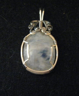 P-41 Moonstone cabochon wrapped in sterling silver $35.jpg